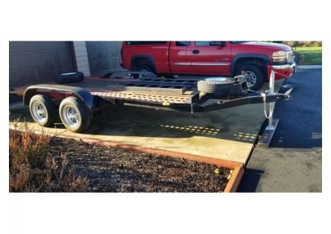 19 foot, tandem axel, flat bed trailer         flat bed trailer with steel loading ramps.  Lights wo